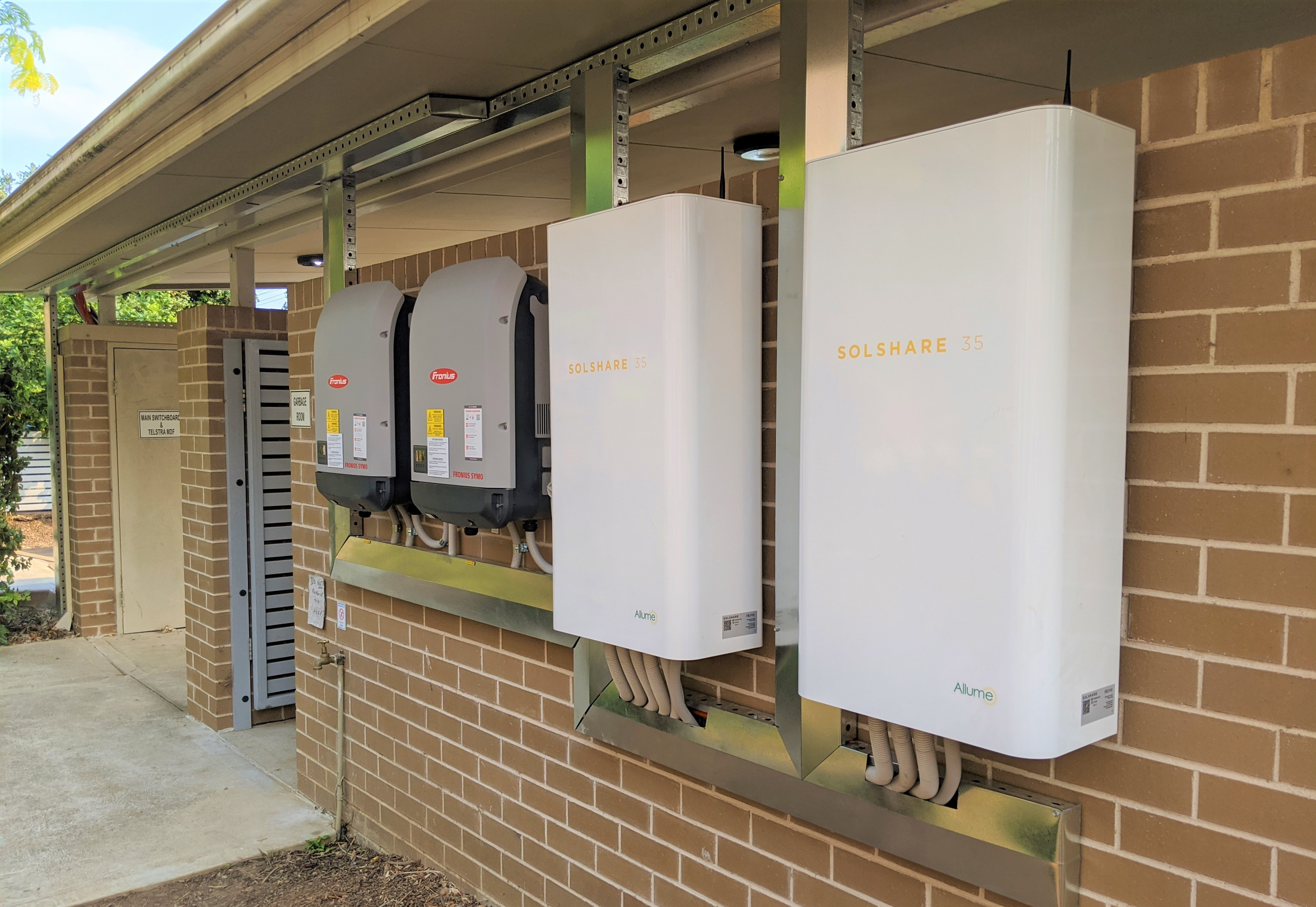 Two SolShares installed on an apartment building