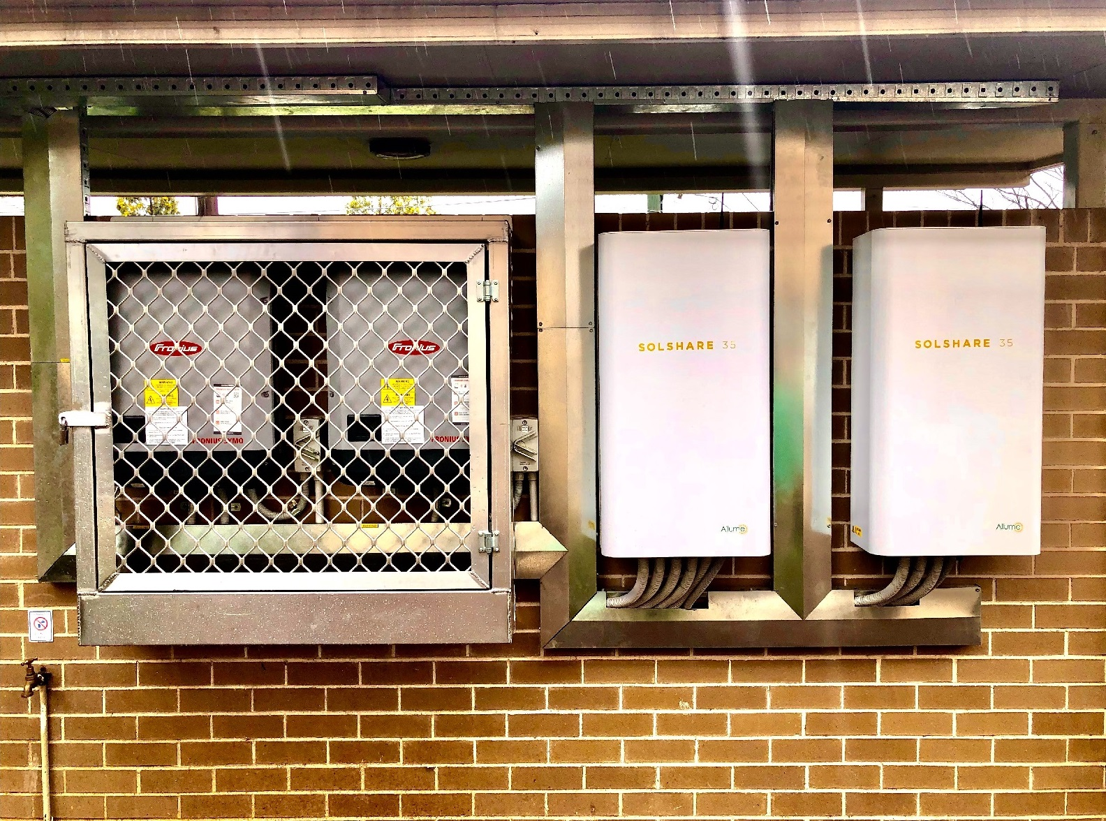 Two SolShare 35s installed next to two Fronius inverters